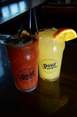 A Bloody Mary, left, with Tito's Vodka, horseradish, olive juice, dry Irish stout and Tabasco sauce sidles up to a Weekend Krush, a cocktail with Three Olives orange vodka, Pedialyte orange and fresh squeezed orange juice. Both are on the brunch menu at The Pour House in Westmont.