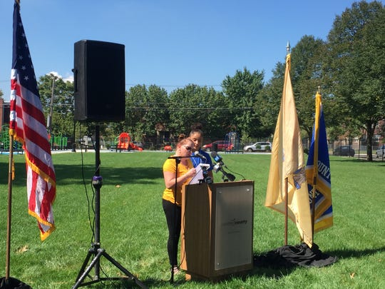 Maritza Camacho (left) and her daughter Arianna speak at the ribbon cutting for Alberta Woods Park in East Camden.