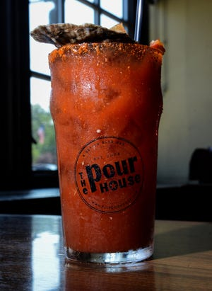 A Bloody Mary prepared with Tito's Vodka, horseradish, olive juice, dry Irish stout and Tabasco sauce is served on the brunch menu at The Pour House in Westmont.