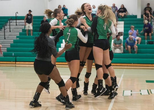 Huntington's volleyball team celebrated after defeating powerhouse Unioto 3-2 Tuesday night at Huntington High School.