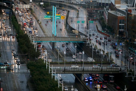 Traffic comes to a crawl along Ft. Washington Way after a thunderstorm caused flooding Wednesday, September 5, 2018.
