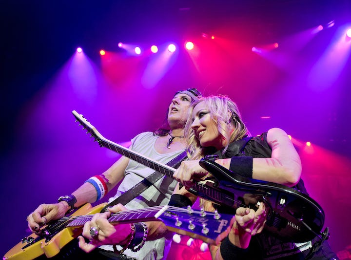 Ryan Roxie and Nita Strauss perform in Alice Cooper's band.