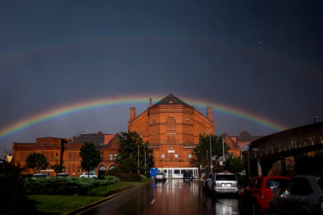 A double rainbow forms over Music Hall in downtown Cincinnati during a rainstorm Wednesday, September 5, 2018.