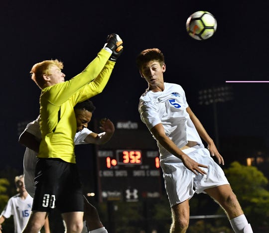 Moeller's Cal Collins makes an important save late in the match to keep things tied 1-1 Tuesday, Sept. 4, 2018 at Gettler Stadium on the campus of the University of Cincinnati