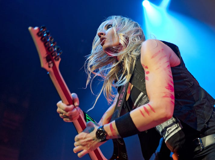 Nita Strauss performs in Alice Cooper's band.