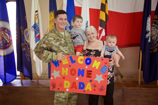 Staff Sgt. Jeremy Moseley, his wife, Taija, and their sons, pictured here during a redeployment. The family says they experienced a bad move from Fort Campbell to Colorado, and blame a Clarksville moving company.
