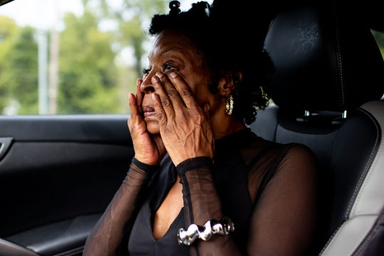 """Penny Hooker wipes away tears as she speaks about her son, Chris Young, who will not attend the funeral of Dorothy Brown-Ogburn, who he considered his grandmother and helped raise him, outside of Hooker's Funeral Home, Wednesday, Sept. 5, 2018, in Clarksville, Tenn. Young was sentenced to life in prison in 2014 for federal drug and firearm charges. His biggest fear was his """"Big Mama""""dying before he was free, according to Brittany Barnett who says Young was her client."""