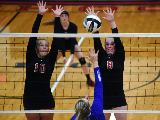 Coshocton's Zavia Stanton, left, and Morgan Bryant go up for a block during the Redskins' 23-25, 25-23, 25-22, 23-25, 18-20 loss to visiting Cambridge on Tuesday.