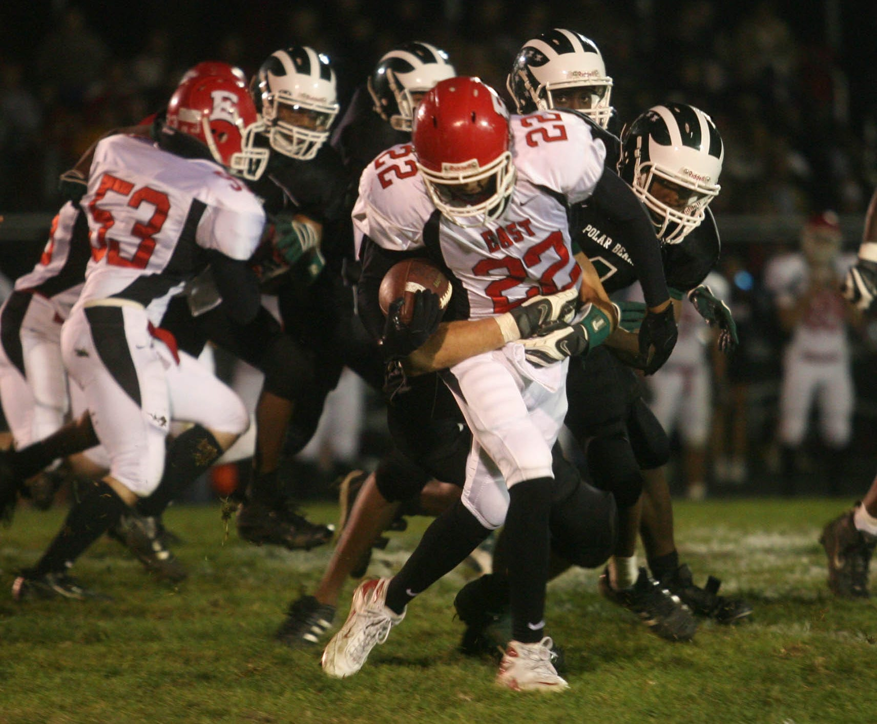 East's Juan Rincon (22) looks to break away from a North defender during the Des Moines rivalry game in 2007 at North High School.
