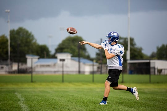 Anthony Potthoff, quarterback for the Van Meter High School football team, makes a pass during practice on Tuesday, Sept. 4, 2018, at the team's practice field in Van Meter. Anthony's brother Alec was injured, and later killed, in a boating accident earlier this summer. On the day of his funeral his brother lead the Van Meter football team to a 42-14 win against Earlham.