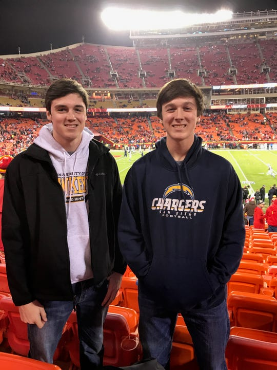 Alec and Anthony Potthoff, brothers from Van Meter, at Arrowhead Stadium in Kansas City for a Chiefs-Chargers game. Anthony, on the right, is a big Chargers fan.