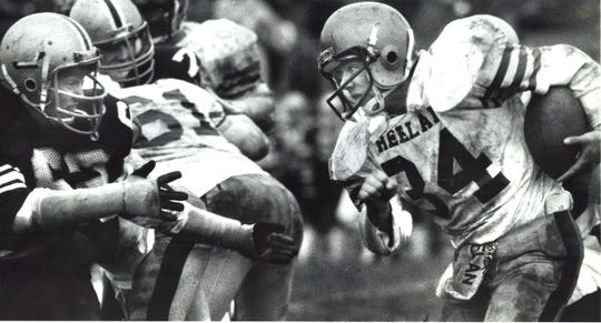 Heelan's Charlie Lara (34) meets Dowling's Rob Ford during a 1985 football game.