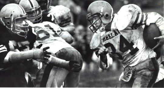 Heelan's Charlie Lara (34) meets Dowling's Rob Ford during a 1985 football game.