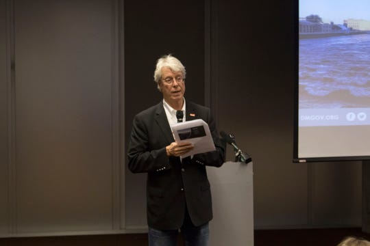 Des Moines Mayor Frank Cownie discusses the city's response to flash flooding at a public meeting Tuesday at the Des Moines Public Library's downtown branch.