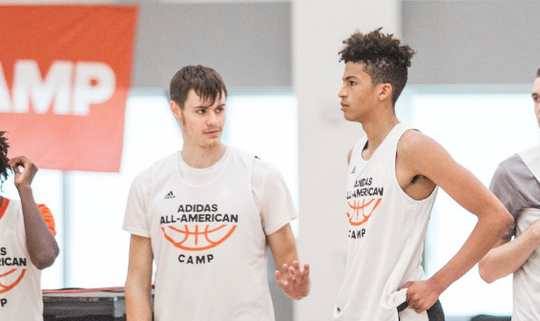 Iowa State forward recruit Luke Anderson (left) chats with a teammate during the Adidas All-American Camp.