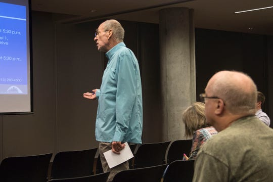Beaverdale resident Roger Hill criticizes Des Moines' response to flash flooding at a public meeting Tuesday evening at the Des Moines Public Library's downtown branch.