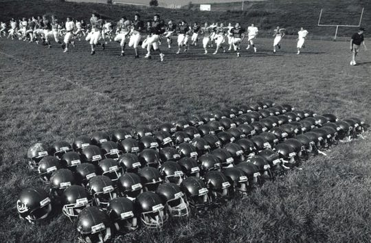In 1987, Sioux City East was considered Iowa's largest high school football team. On this August morning, it had 98 kids at practice.