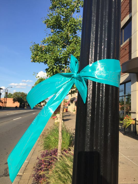 A teal ribbon tied to a light pole on Michigan Avenue on Sunday, Sept. 2, 2018.