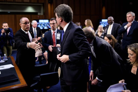 Fred Guttenberg (L), father of Stoneman Douglas High School mass shooting victim Jaime Guttenberg, peaches to shake the hand of Brett Kavanaugh (C) during a hearing of the Senate Judiciary Committee on the nomination of Brett Kavanaugh to the US Supreme Court Sept. 4, 2018, in Washington, DC.