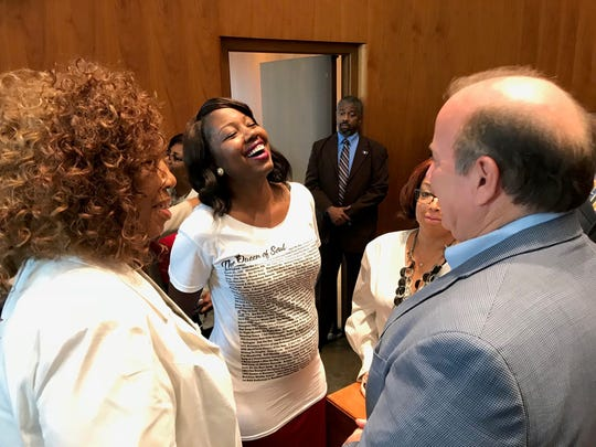 Aretha Franklin's niece, Cristal Franklin, chats with Mayor Mike Duggan Tuesday before the Detroit City Council votes to rename Chene Park Aretha Franklin Amphitheatre.