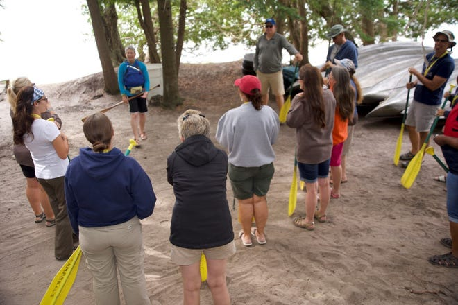 In July, eighth-grade environmental science teacher Leslie Montgomery picked up some practical paddling techniques from an expert canoeist on Higgins Lake as part of this year's Academy of Natural Resources.