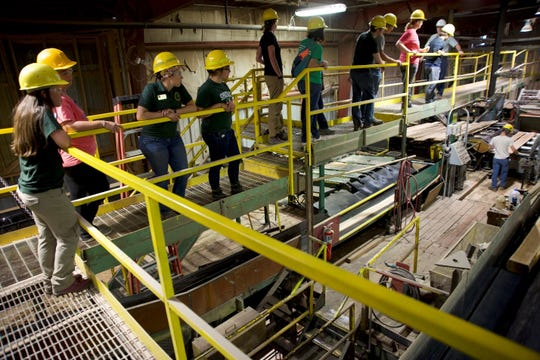 West Michigan instructor Avril Wiers and a group of about 15 others learned about the lumber industry and how it relates to Michigan's natural resources.