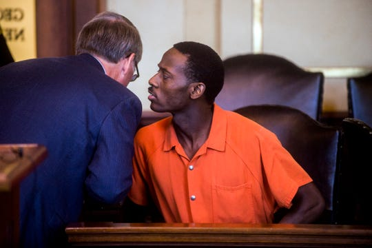 Khairy J. Simon, 27, speaks to his defense attorney Philip H. Beauvais III after he was sentenced to 12 to 40 years for his role in the 2015 murder of his daughter, Kimora Lee Simon, on Wednesday, Sept. 5, 2018, at Genesee Circuit Court in Flint, Mich.