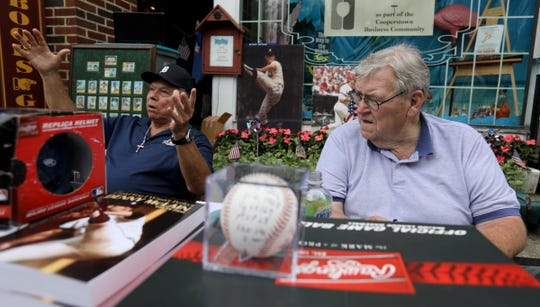 Former Detroit Tigers players Darrell Evans, left, and Denny McLain talk to fans July 27, 2018 in downtown Cooperstown, N.Y.