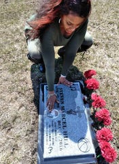 Lorease Mumford visits the gravesite of her son Steven Marcel Hill in August, 2017 at Mt. Hope Memorial Gardens in Livonia.