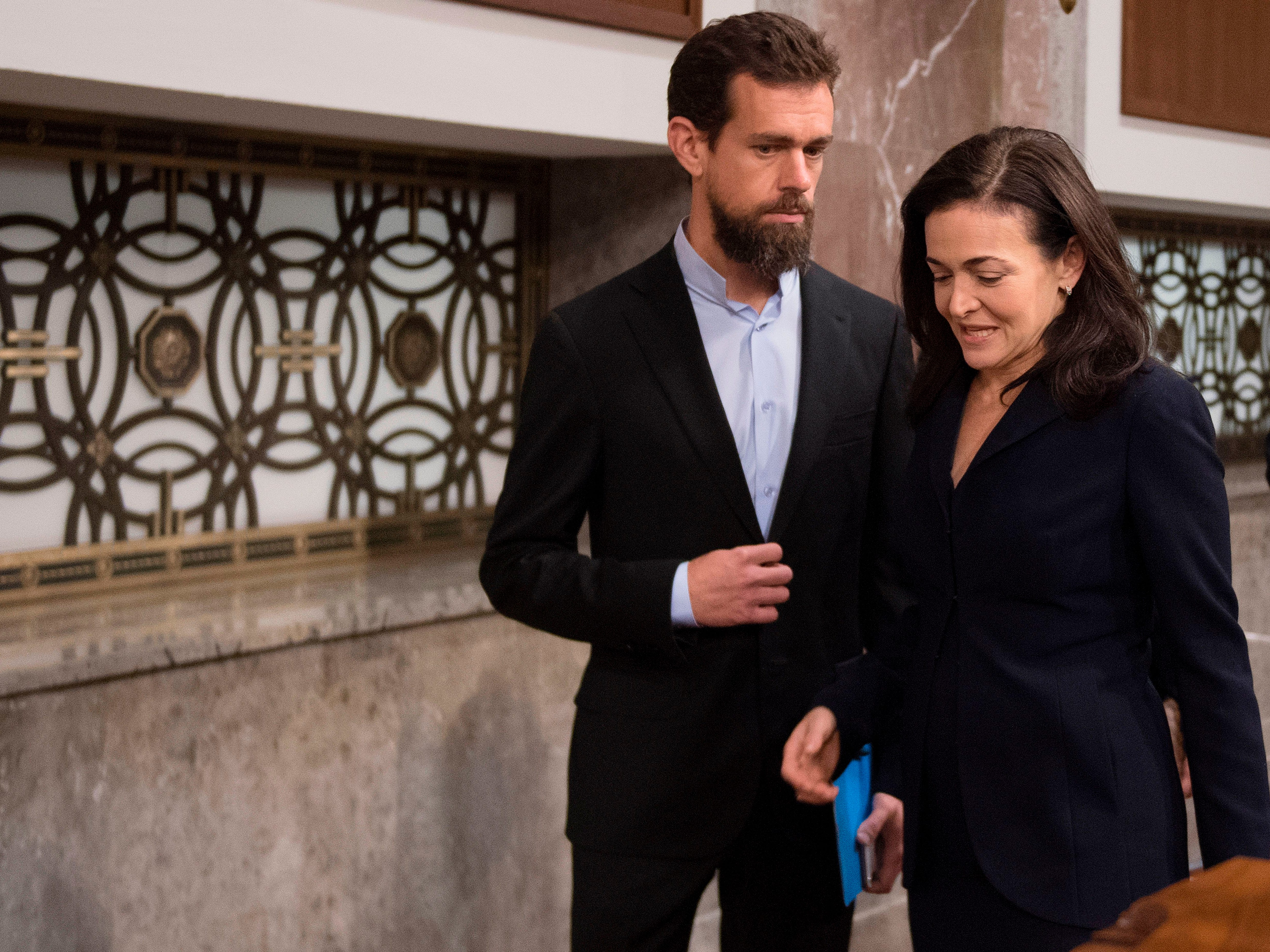 CEO of Twitter Jack Dorsey and Facebook COO Sheryl Sandberg arrive to testify before the Senate Intelligence Committee on Capitol Hill in Washington, D.C., on Sept. 5, 2018.