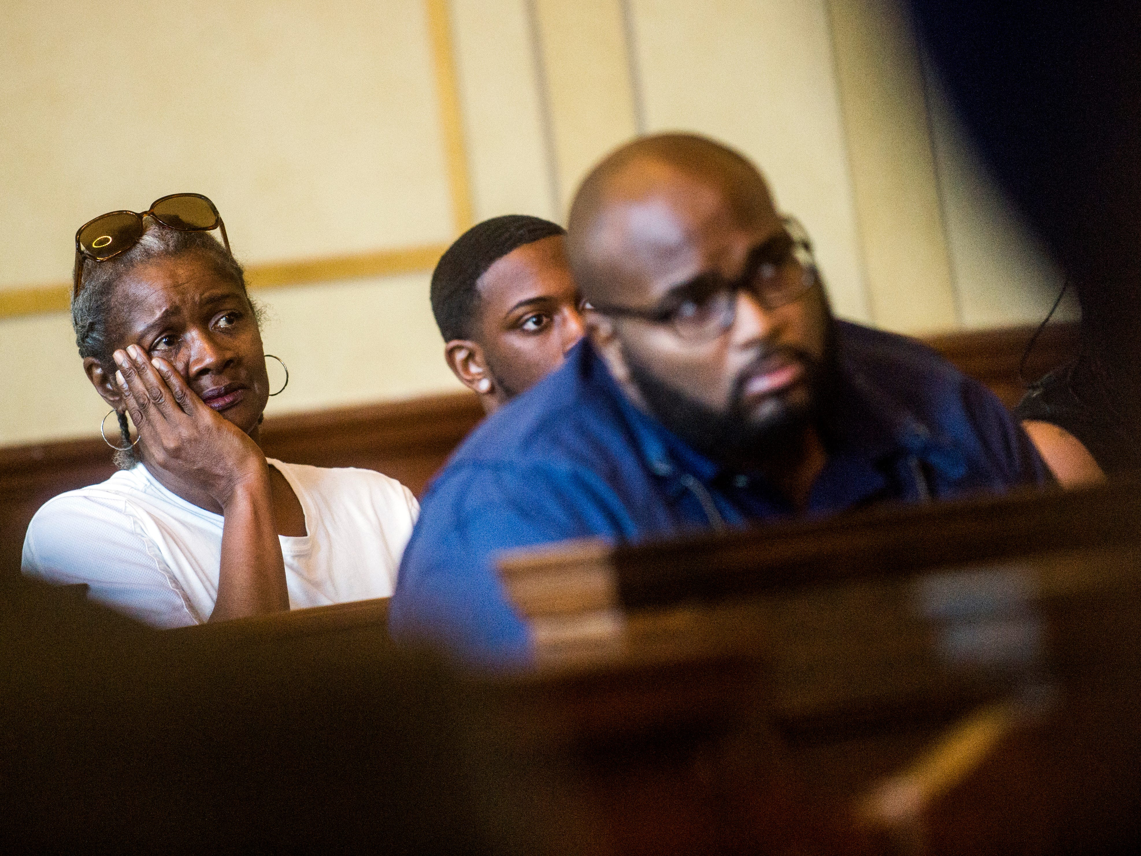 Family members of Erika Finley, 29, listen from the gallery to Genesee Circuit Judge Geoffrey L. Neithercut sentence Finley on Wednesday, Sept. 5, 2018 at Genesee Circuit Court in Flint, Mich. Finley will spend the next 15 to 40 years in prison for the 2015 murder of her daughter, Kimora Lee Simon.