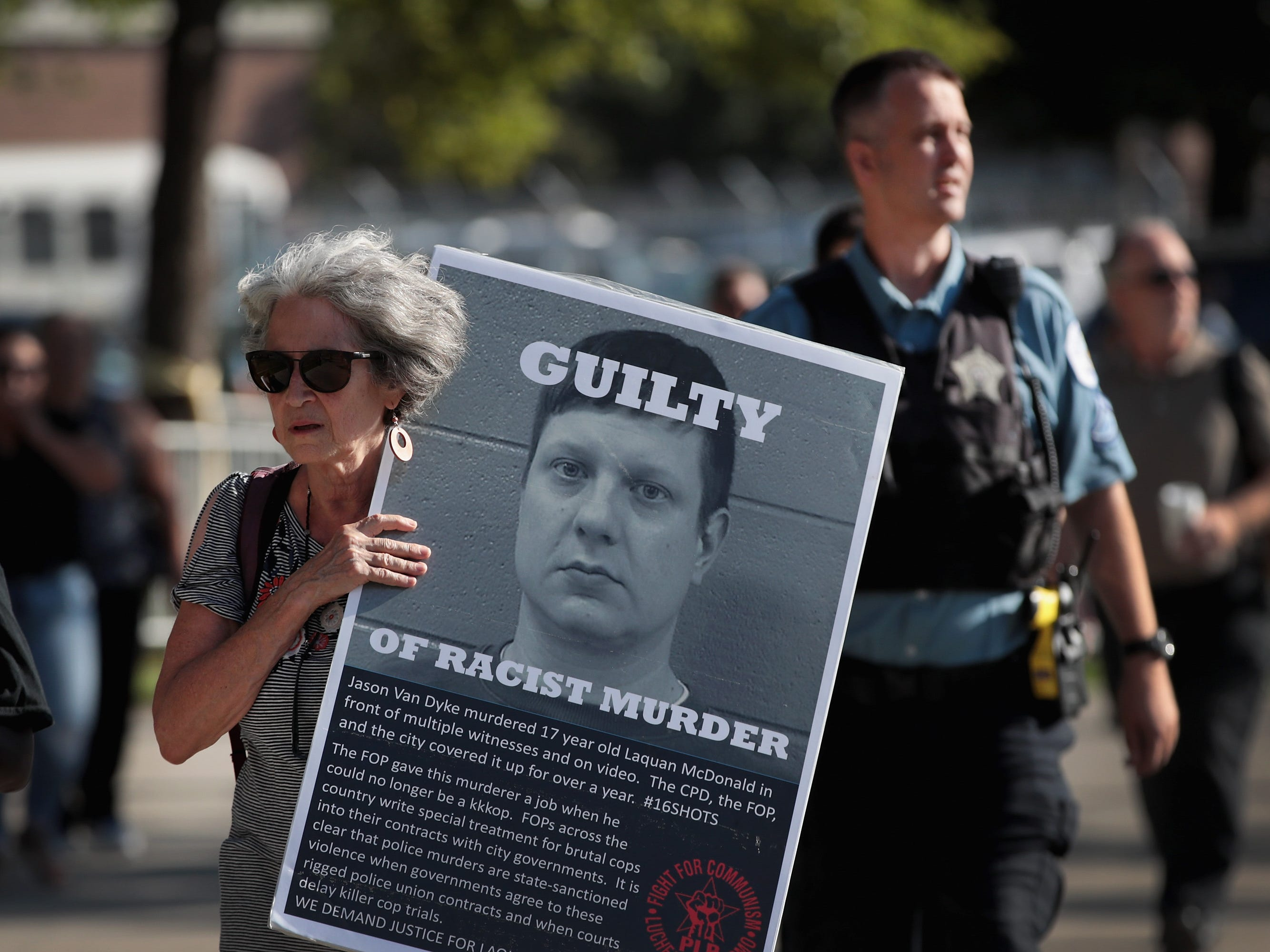 Demonstrators protest outside of the Leighton Criminal Courts Building as Jury selection begins in the murder trial for Chicago police officer Jason Van Dyke on Sept. 5, 2018 in Chicago. Van Dyke is accused of shooting 17-year-old Laquan McDonald 16 times and killing him on Oct. 20, 2014. Protests erupted around the city after video of the shooting was released.