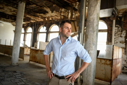 Rino Soave, founder of Novi based Infinity Homes & Co., stands inside the top floor of the Park Avenue building.