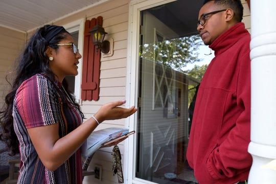 For Our Future Field organizer Viviana Alamillo talks to Decarri Davis, 18, about getting registered to vote.