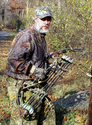 Elmira bow hunter John Collum prepares to step into the woods near Horseheads in this 2011 photo.