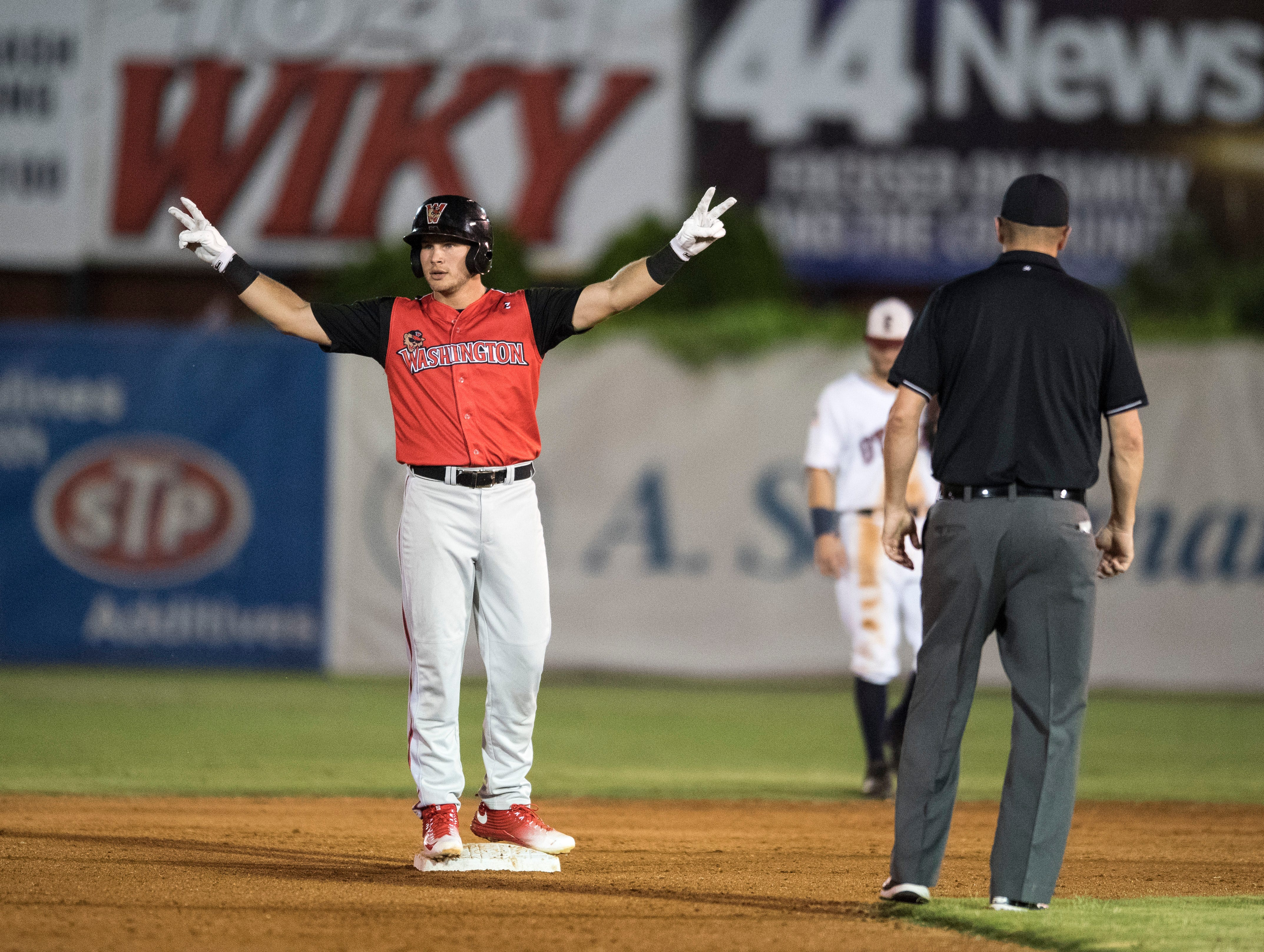Washington's Dom Lero (7) signals to his teammates after taking second base during game one of the Frontier League Division Series at Bosse Field against the Evansville Otters Tuesday, September 4, 2018.
