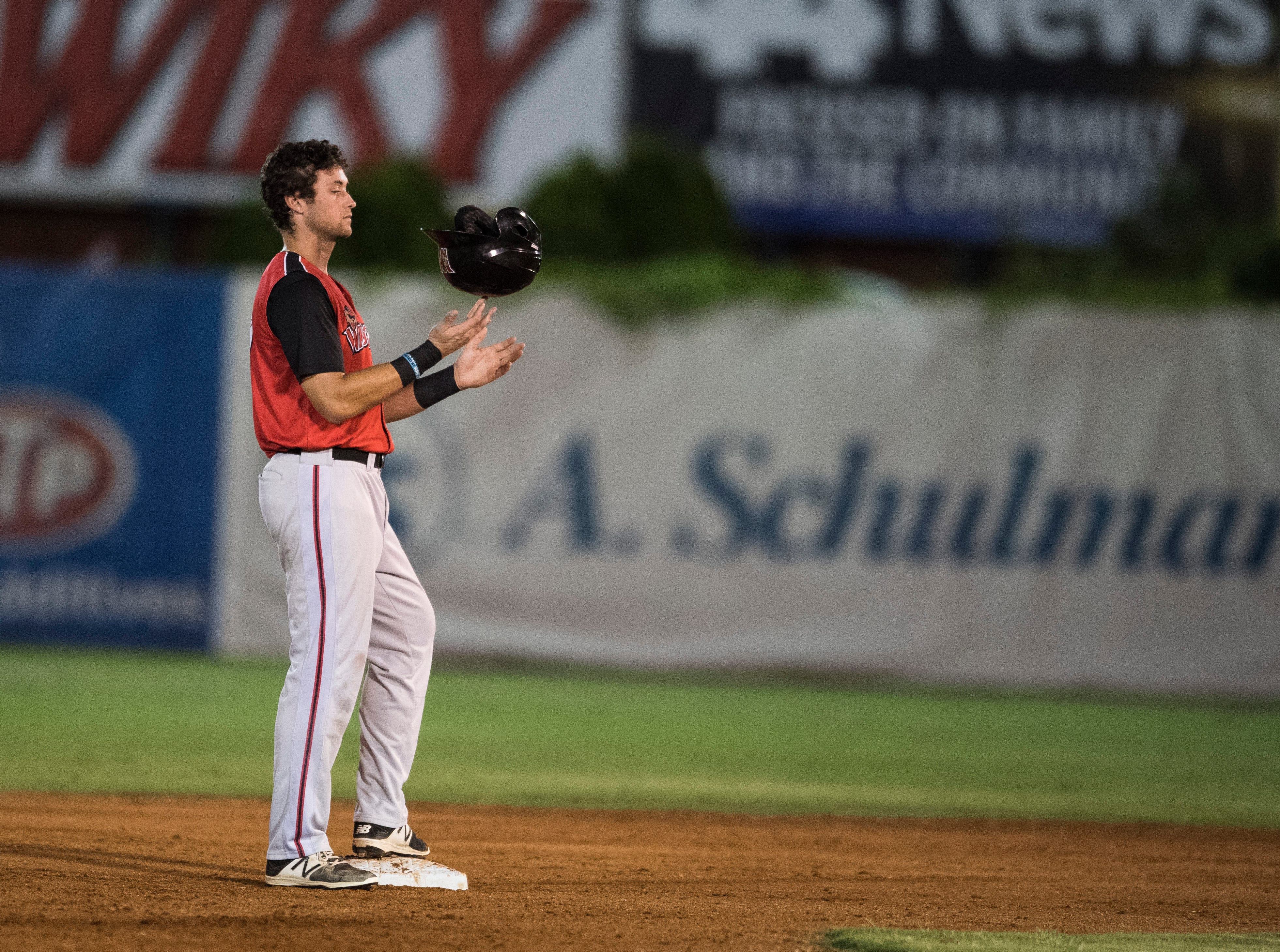 Washington's Roman Collins (19) spins his batting helmet on his figure as he waits on second base while the Otters switch pitchers during game one of the Frontier League Division Series at Bosse Field against the Evansville Otters Tuesday, September 4, 2018.