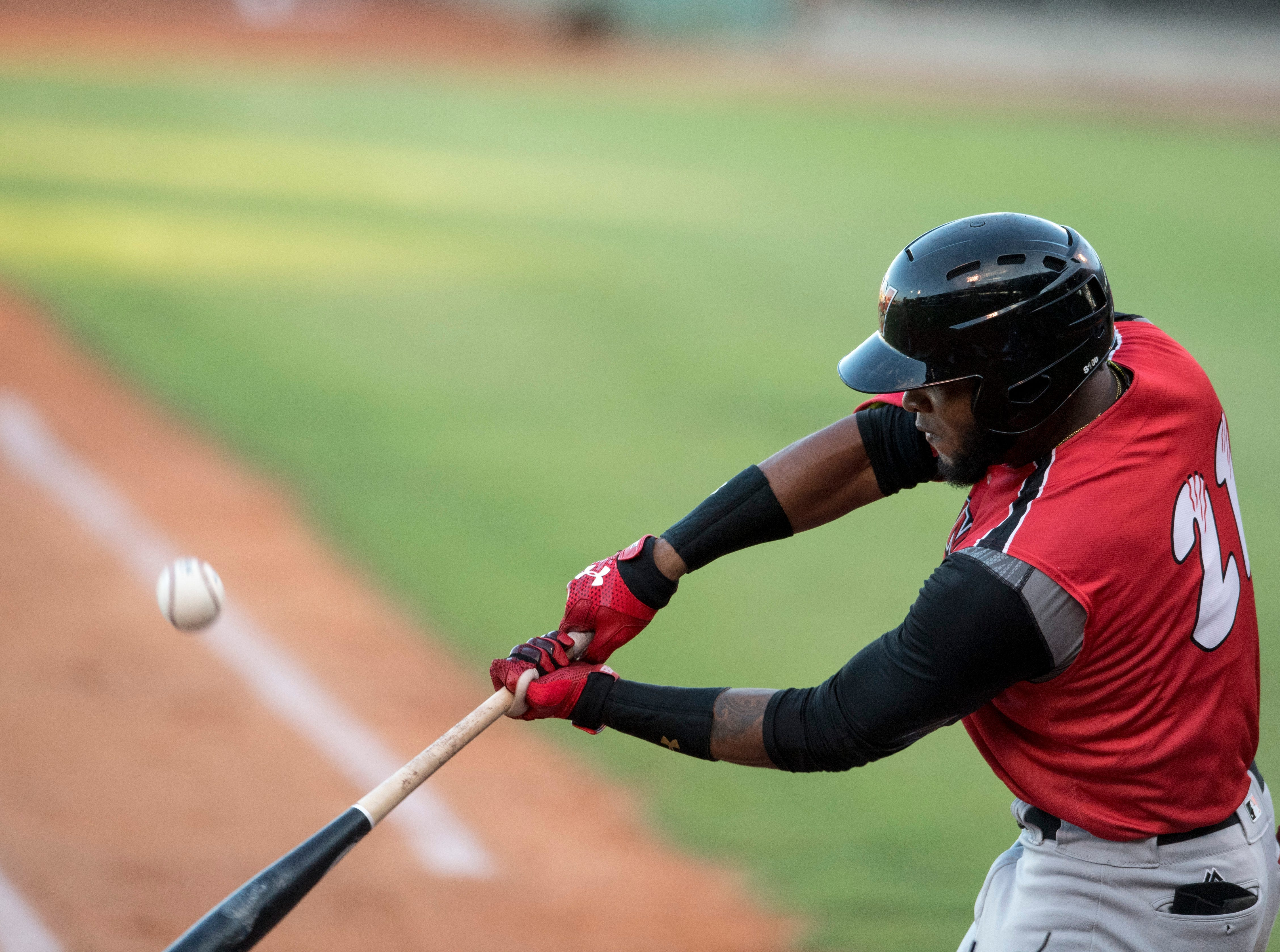Washington's Reydel Medina (21) swings at the ball during game one of the Frontier League Division Series at Bosse Field against the Evansville Otters Tuesday, September 4, 2018.