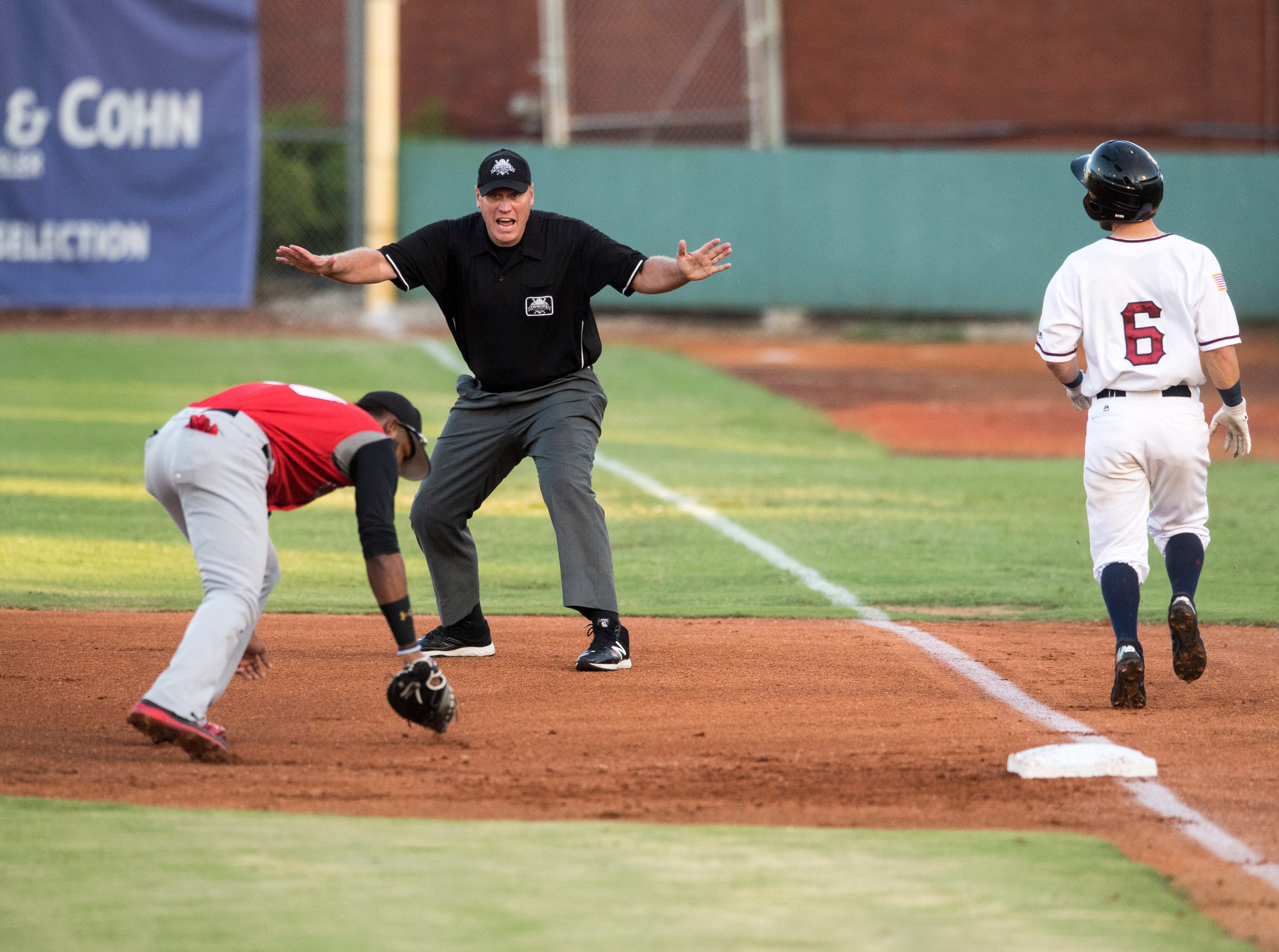Evansville's David Cronin (6) is safe at first base after Washington's Reydel Medina (21) struggles with the ball during game one of the Frontier League Division Series at Bosse Field against the Evansville Otters Tuesday, September 4, 2018.