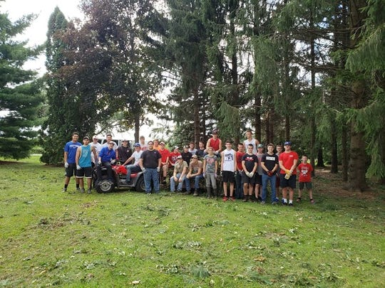 Volunteers from Lomira High School helped to clean up Lomira and Brownsville after tornadoes came through on Aug. 28.
