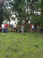 Volunteers from Lomira High School are pictured taking part in clean up.