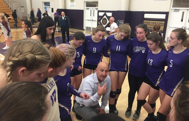Fort Collins volleyball coach Jared Rudiger talks to his team during a game last season.