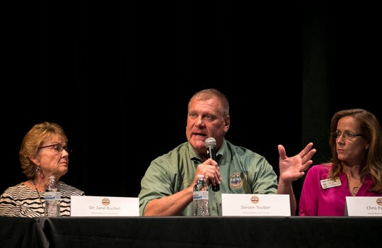 Steven Teuber of the Lee County School Board answers a question at a town hall meeting Wednesday about the proposed 1/2 cent sales tax to fund capital projects for the Lee County School District.