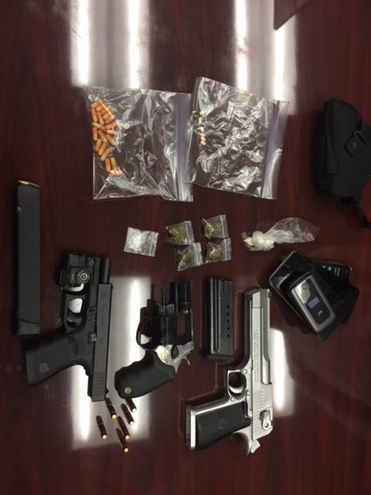 Detectives seized narcotics and firearms in the bust.