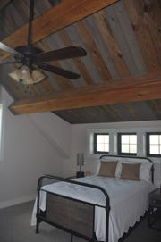 The Cabin model has a rustic look with wood beams across the ceiling.