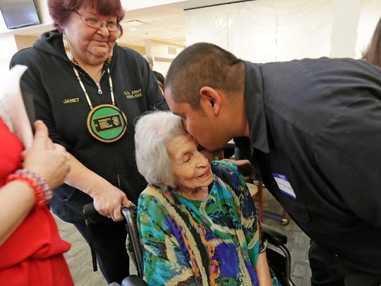 Rose Skenandore Kerstetter celebrated turning 100 years old Wednesday at the Anna John Residential Care Center on the Oneida Reservation in Hobart. Her grandson Tatoka Skenandore of New Mexico gives her a kiss of greeting at the party.