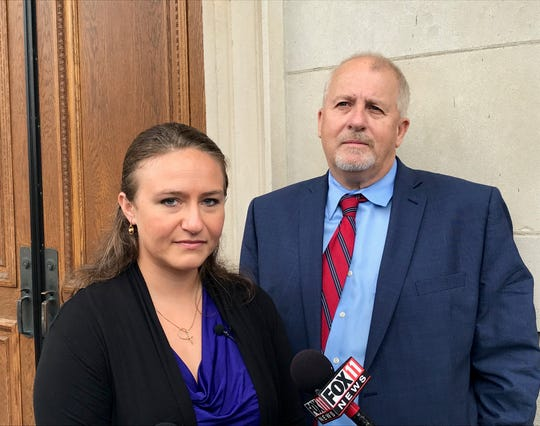 Polly Olsen, a student at Northeast Wisconsin Technical College, is suing the school in federal court for stopping her from handing out Valentine's Day cards with Bible verses. With her is Rick Esenberg of the Wisconsin Institute for Law & Liberty, who filed the lawsuit on her behalf.