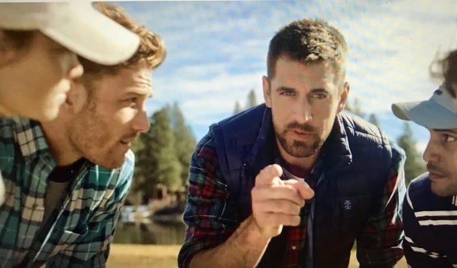 Aaron Rodgers huddles up in a humorous new ad for IZOD.