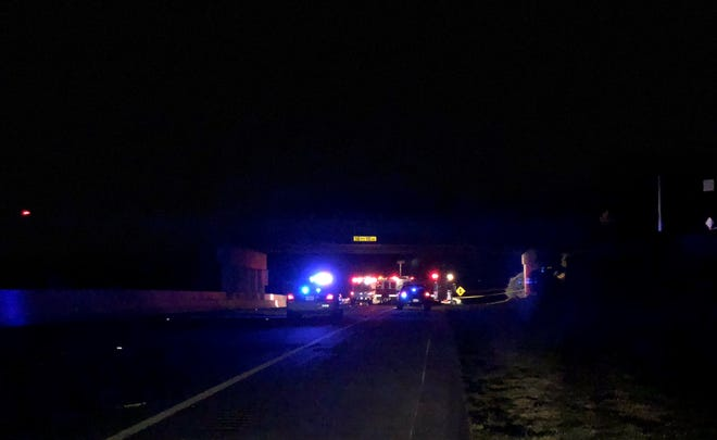 Police respond to a body found on Interstate 385.
