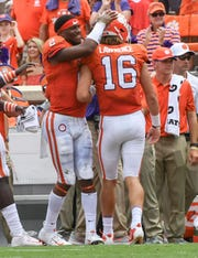 Kelly Bryant (2) congratulates fellow quarterback Trevor Lawrence (16) after Lawrence threw the first touchdown pass of his career last Saturday against Furman.